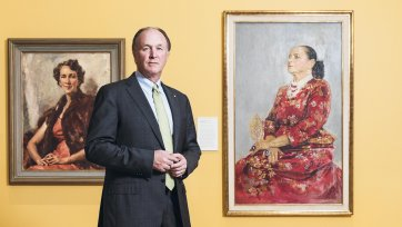 Sid Myer AM in front of Helena Rubinstein in a red brocade Balenciaga gown 1957 by Graham Sutherland. Purchased with funds provided by Marilyn Darling AC, Tim Fairfax AC and the Sid and Fiona Myer Family Foundation 2015.