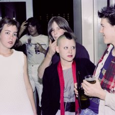 Guthugga Pipeline, Christmas Show, upstairs, The (old) Griffin Centre, Civic, 22 December 1979. Crowd, L-R : Ben Donaldson, Anne Redmond, Nick Vollis, Esa  Makela, Megan Woodrow (Mohawk), Andy Hall (scarf) 'pling